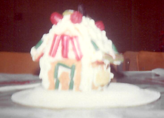 a 3rd gingerbread house on a small box